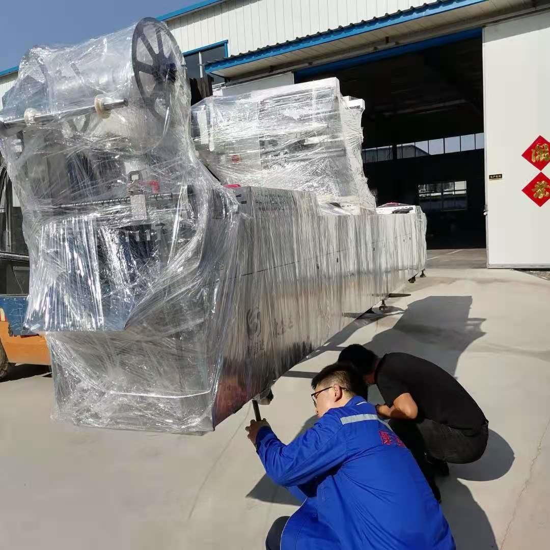定制版加长全自动连续拉伸膜真空包装机发货新疆